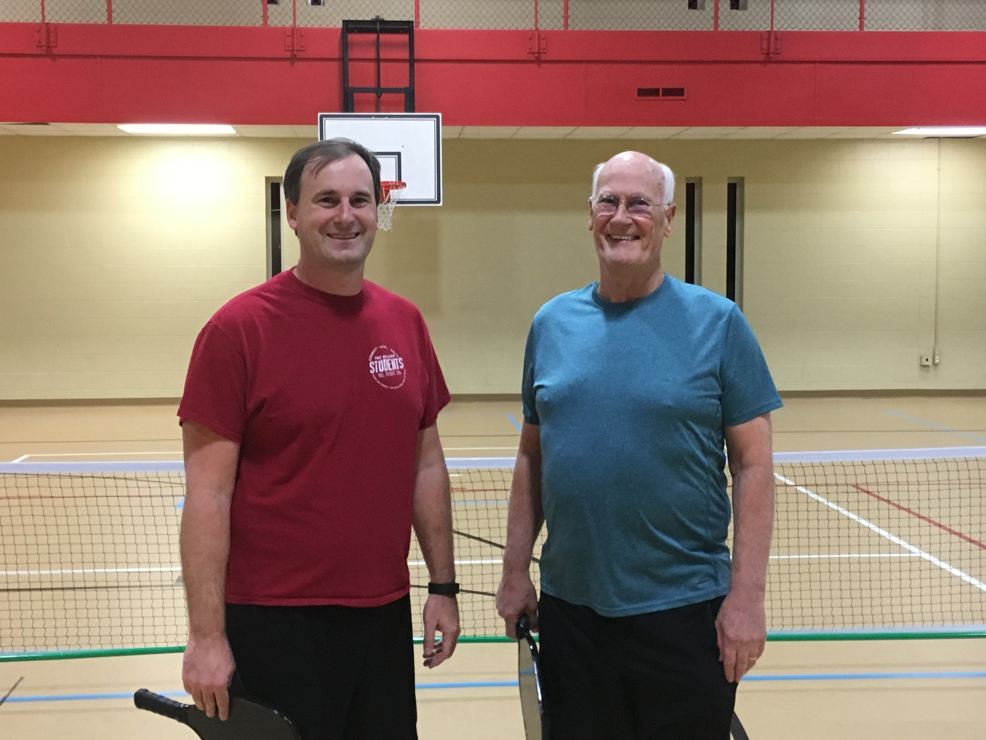 father and son playing pickleball in trussville, birmingham pickleball, pickleball, family pickleball, southside baptist church, southside, alabama