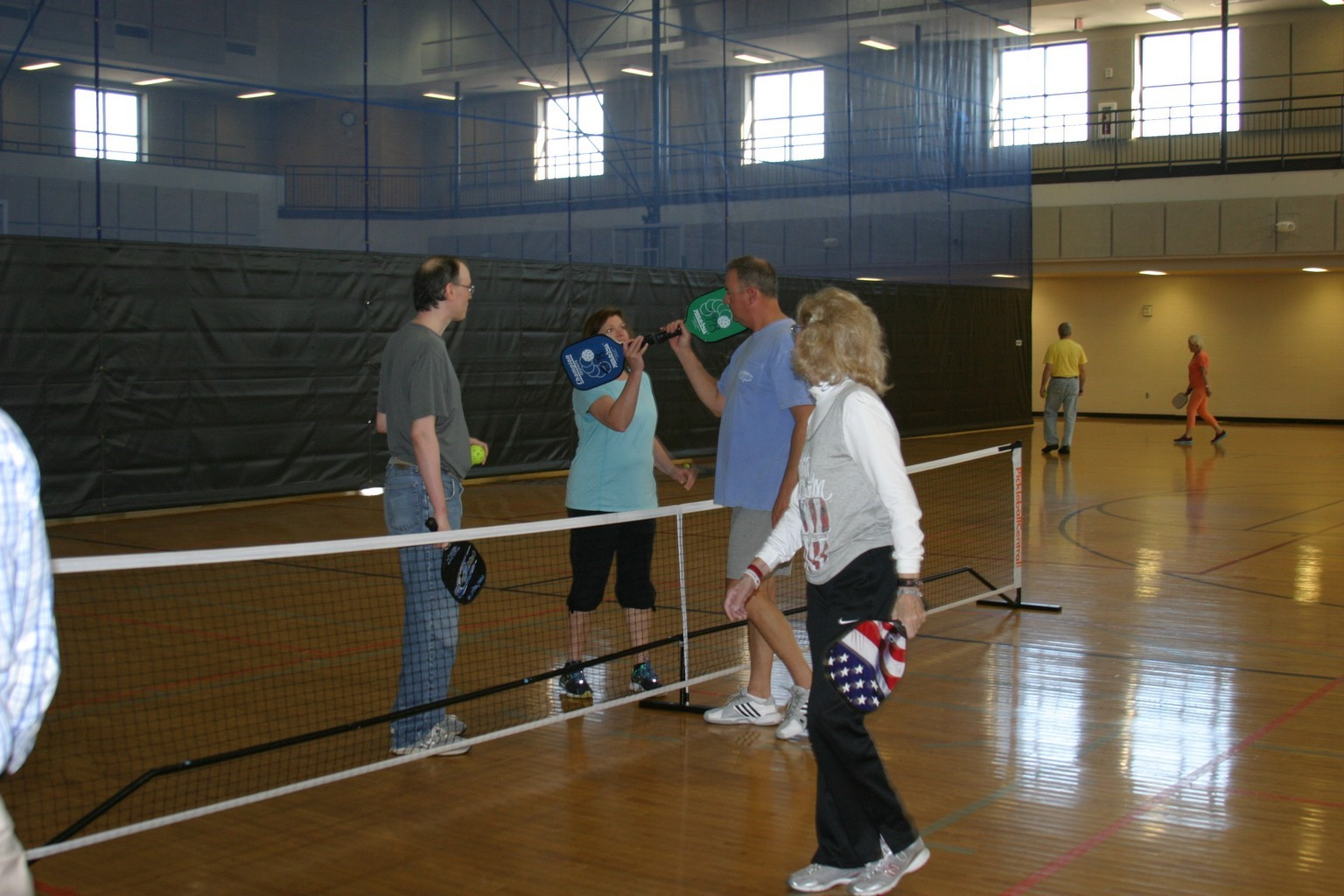 husband and wife, mother and son playing pickleball in trussville alabama, alabama pickleball, trussville pickleball, birmingham pickleball